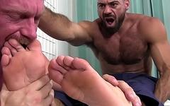 Bald gay masturbates his cock while sucking hunks feet