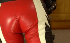 Tight leather bike suit ass