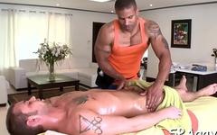 Hot hunk is getting his pecker sucked by homo massagist