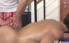 Hot hunk is getting his pecker sucked by homo massage therapist