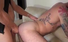 Inked bear gets doggystyle unsaddled by stud