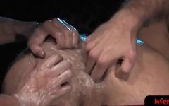 Hot gay stud digs his arm into ass deep