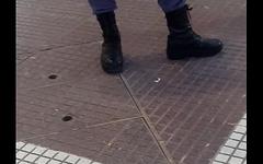 Bulto de Polic&iacute_a en la calle