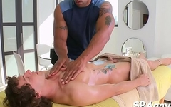 Gay masseur is giving mate a wild blowjob session