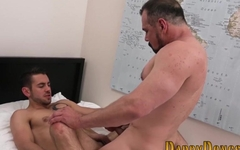 Handsome twink pleasuring his gay daddy in bed