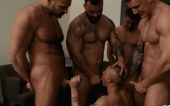 Insatiable twink takes care of four massive dicks at once