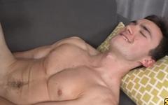 Passionate gay stud masturbates in the living room